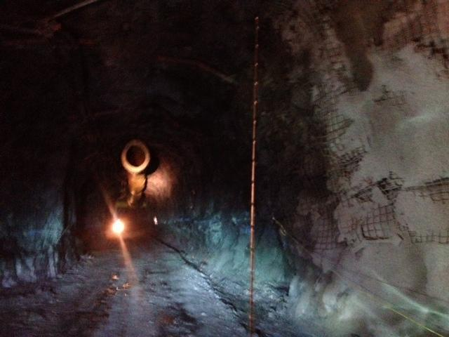 Seven hundred feet underground, the only light comes from headlights and headlamps.