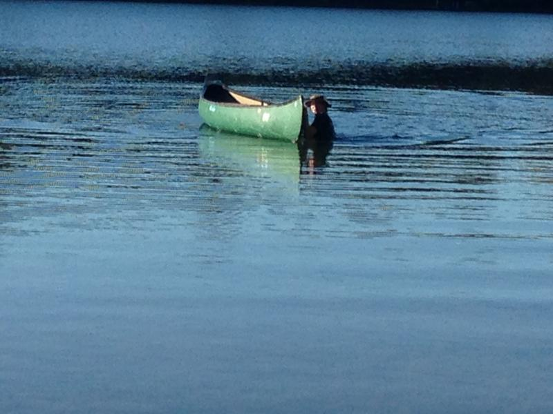 "Carol swimming for the ""adrift"" canoe"