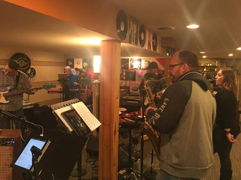 Buck Kipper on saxophone, Melissa Salaam as lead singer, John Scheuer on guitar, Tony Hjelle on keyboard and Bill Padgett on bass. Not pictured: Jason Lowry on guitar and Brett Petrick on drums