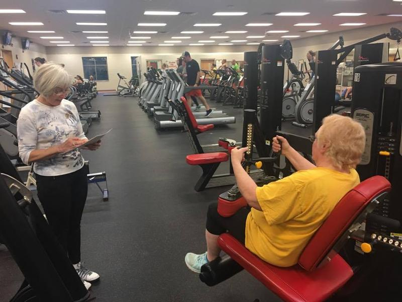 Marilyn Duschl watches as Gloria Baker completes her exercises on the weight machine