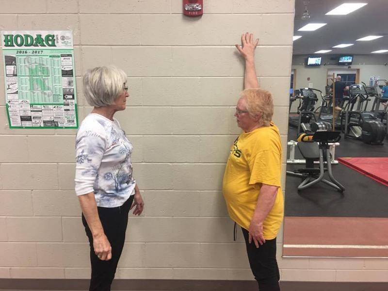 Marilyn coaching Gloria through her stretches