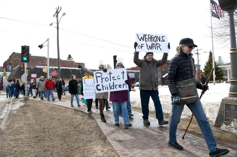 Gun reform advocates march down the Main Street of Minocqua during Saturday's March for Our Lives, which was also held in numerous cities and towns across the nation and elsewhere in the world.