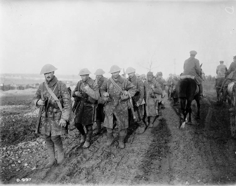Canadian soldiers returning from trenches during the Battle of the Somme, November 1916.