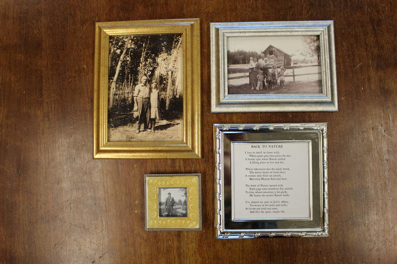 Family photos of Herman Luttkus and a framed poem by Enos Hayward.