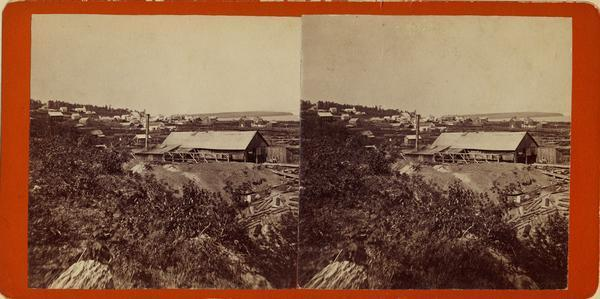 Stereograph image of a sawmill.