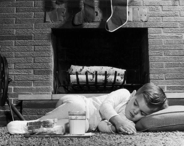 Child sleeping waiting for Santa Claus to arrive.
