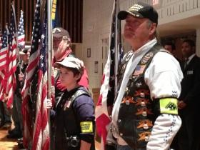 Patriot Guard Riders stand at attention during Nazareth College Veterans Day award ceremony.