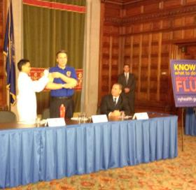 Governor Cuomo gets vaccinated for the flu by Health Comm Nirav Shah, at an event where he also talked about gun control negotiations with the legislature