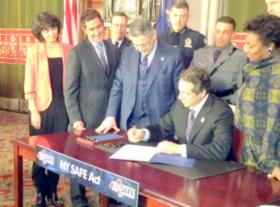 Cuomo signed the new gun control laws at the Capitol Tuesday