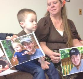 Nancy Bevins, with photos of her son CJ, who died in a gas drilling accident in NY,  along with CJ Bevins son.