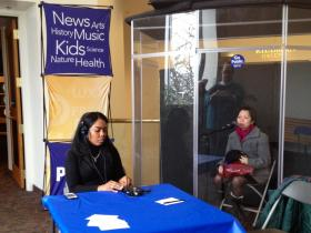 WXXI's Carlet Cleare records a story at the WXXI Listening Booth