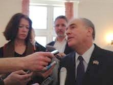State Comptroller Tom DiNapoli speaks with reporters after an address at SUNY's Rockefeller Institute on the financial plight of local governments