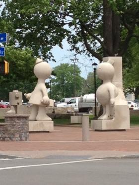 Tom Otterness's Creation Myth piece at the corner of N. Goodman Street and University Avenue.