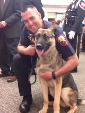 """K-9 Unit dog """"Chip"""" and his handler Officer Jeff Phillips at the Greece Town Hall."""