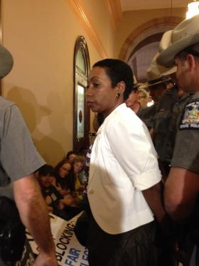 NYS NOW President Zenaida Mendez is one of 21 arrested at a sit in outside Senator Jeff Klein's office