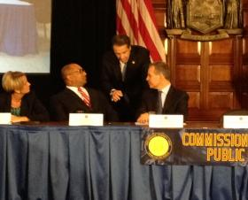 Governor Cuomo chats with state Attorney General Eric Schneiderman, Albany County DA David Soares, at announcement of Moreland Commission to probe the legislature.