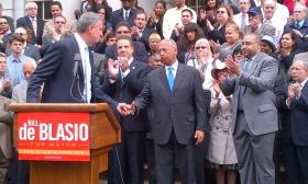 Governor Andrew Cuomo applauds as second place mayoral democratic primary winner Bill Thompson concedes to front runner Bill deBlasio