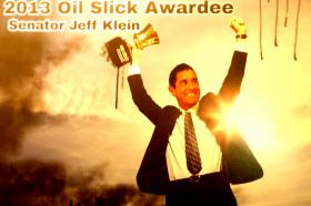 Photo shopped picture of Senator Klein , by Environmental Advocates, to illustrate the awarding of the Oil slick award for 2013