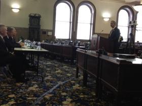 U of R president speaking before Senate Majority Coalition in Legislative Chambers at the Monroe County Office Building