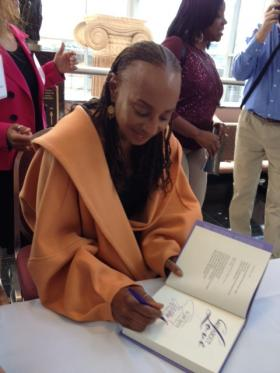 Susan L. Taylor, Editor-In-Chief Emerita of Essence Magazine signing her books after YWCA Empowering Women Luncheon at the Rochester Riverside Convention Center