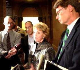 Barbara Bartoletti, with the League of Women Voters, and Blair Horner of NYPIRG  answer questions from reporters