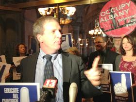 Billy Easton with Alliance for Quality Education, speaks at a rally against Governor Cuomo's budget proposals