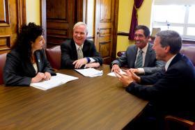 This photo released by the Senate IDC shows Senator Diane Savino, Senator Tony Avella, Senate IDC Leader Jeff Klein, and Senator David Valesky at their first meeting together