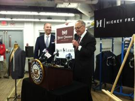 Hickey Freeman CEO Stephen Granovsky and U-S Senator Chuck Schumer announcing deal.