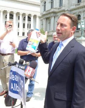 GOP candidate for Governor holds up a bottle of bleach as part of his tour to clean up corruption.