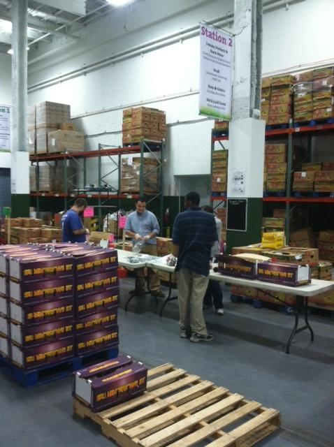 Volunteers at Foodlink's warehouse on Mt. Read Blvd