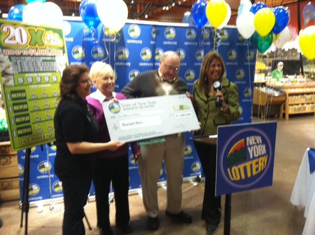Ronald Nau and wife get a Lottery check at the Mount Read Blvd Wegmans