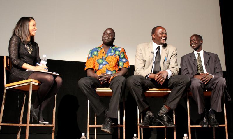 "Hélène Biandudi Hofer, Sebastian Maroundit, Mathon Noi, and Palath Thonchar talk after the ""Schools for South Sudan"" screening at the Little Theatre"