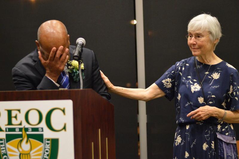 Sr. Barbara Lum comforts Rep. John Lewis at REOC event in 2013