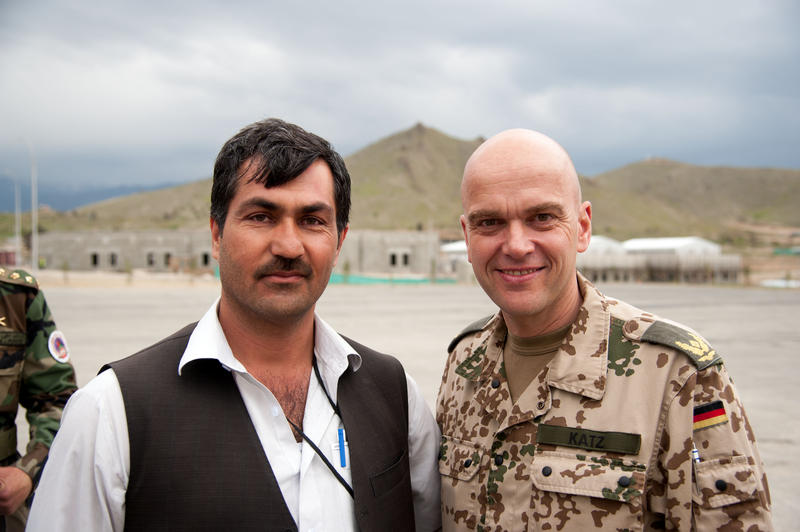 Aziz (left) with Brigadier General Gunter Katz in Kabul, Afghanistan in 2013
