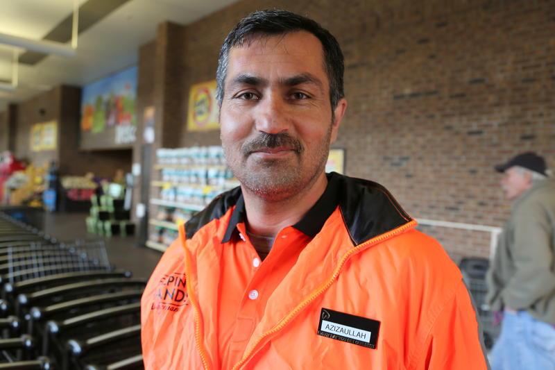 Aziz working at Wegmans