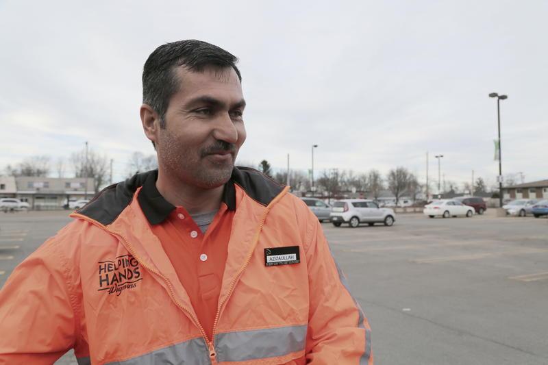 Aziz working as a Helping Hand at Wegmans