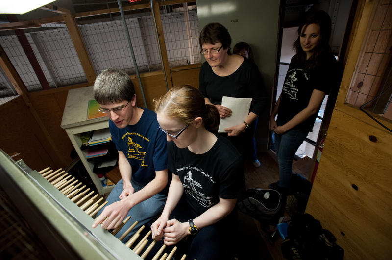 Jeff Kabel '12 of Hollis, NH and Rachel Stuart '14 of Memphis, TN play a duet on the carillon as l-r: adjunct instructor of carillon Doris Aman and fellow students Kelly Guerrieri '14 and Emily Sumner '15 of Bedford, MA watch.