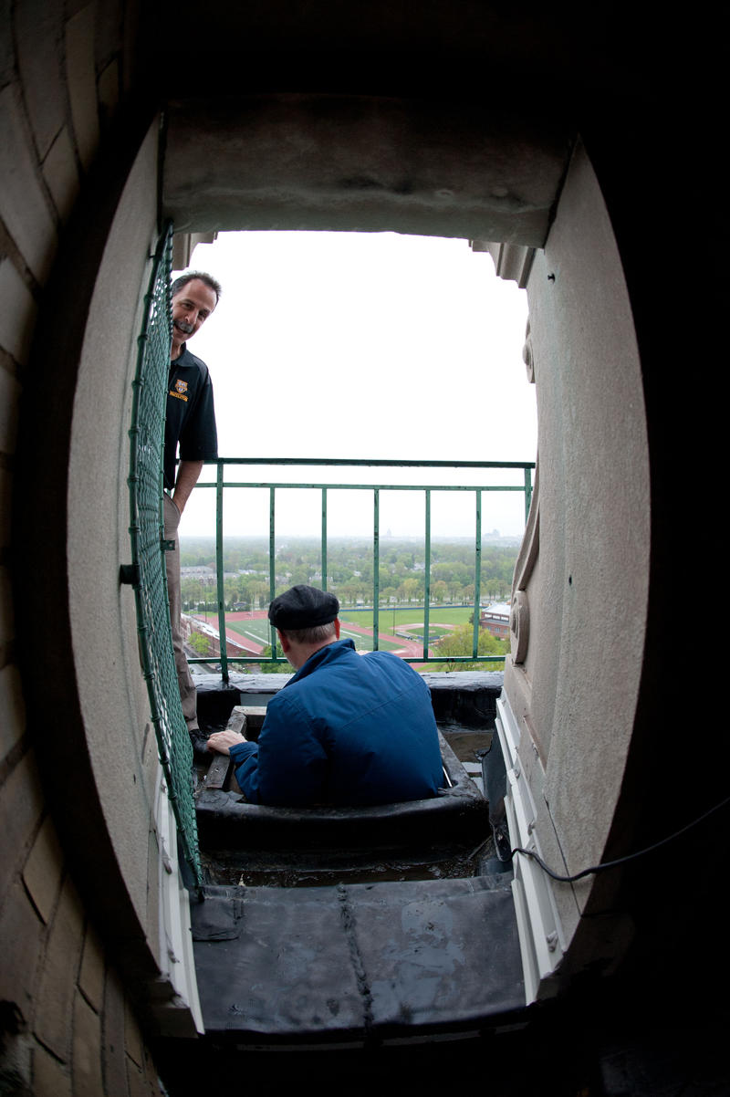 University of Rochester Assistant Director of River Campus Facilities and University Properties Barry P. McHugh and Maintenance Supervisor Mike Zavaglia provide access to the carillon bells at the top of Rush Rhees Library.