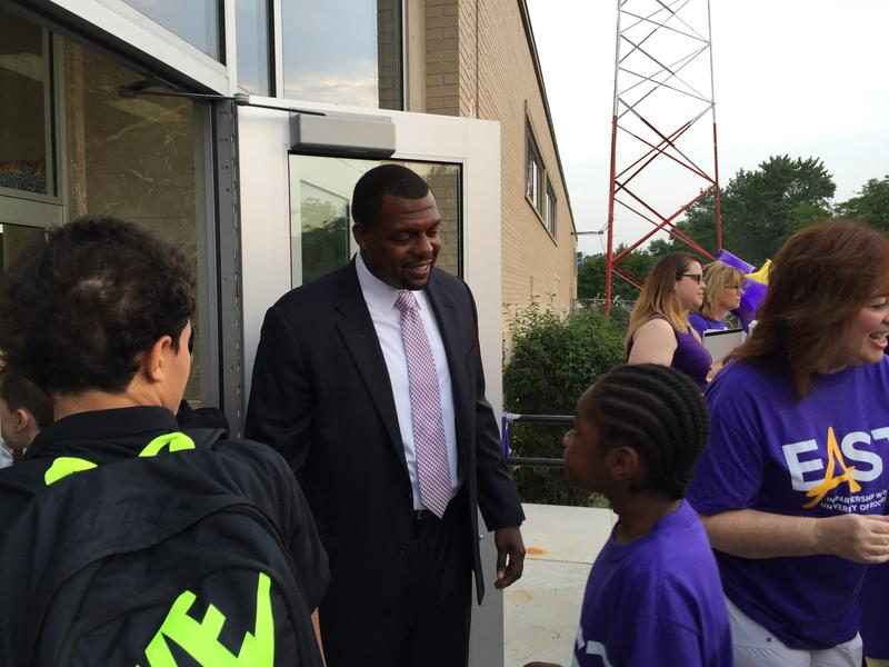 Shaun Nelms greets students on their first day of school.