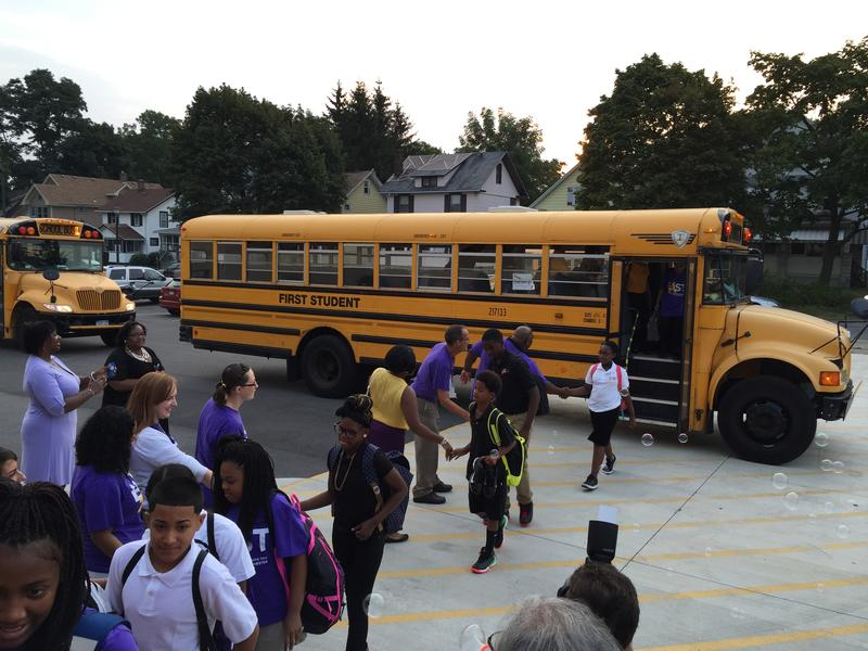 East High School teachers greet students in a festive manner on the first day of school.