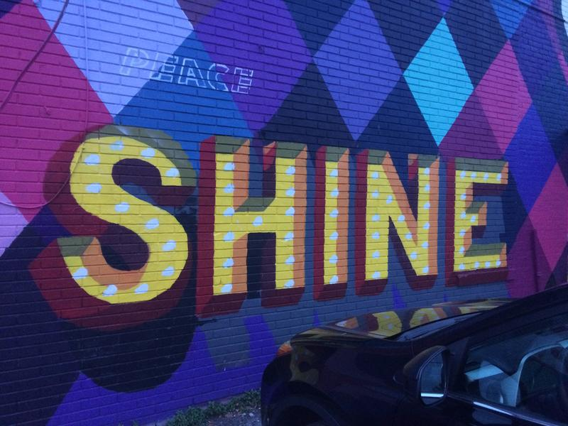 Murals with inspirational quotes decorate the area near Grape and Jay streets.