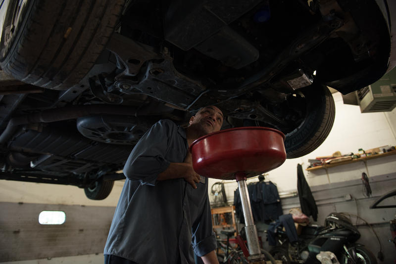 Israel Garcia, 49, of Rochester is a Cuban immigrant who works at Dalbert's Auto Shop as a mechanic during the day and then works the night shift at a Wegmans warehouse, with only a few hours in between to sleep and relax.