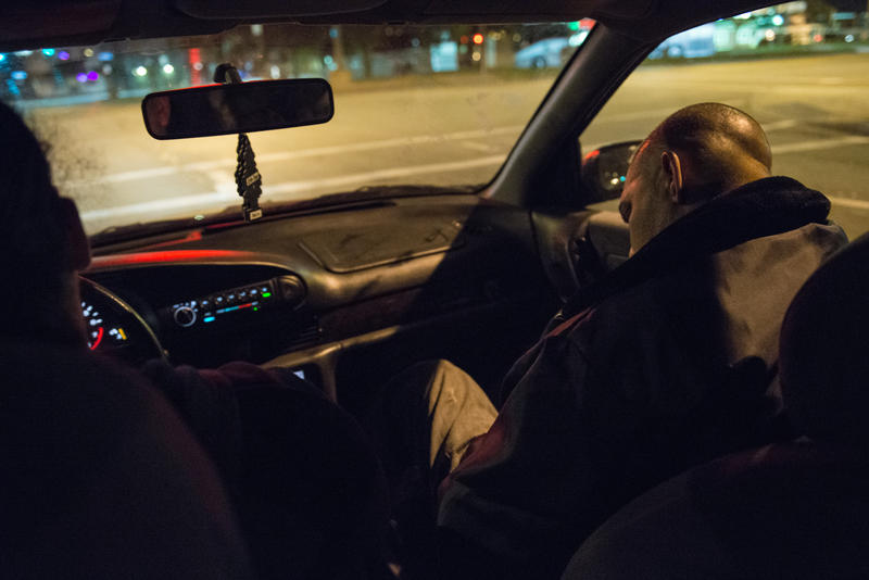 "Israel Garcia falls asleep while being driven to his second job. He said he started working the overnight job to ""feel a little more comfortable,"" but he noted that ""money is not your whole life. With money you can't buy your health."""