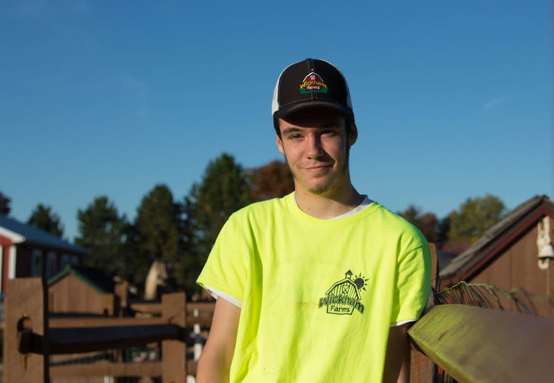 """Justin Edlich, 17, works for minimum wage at Wickham Farms in Penfield. He'd like to see an increase in minimum wage so he can save more for college. For adults earning minimum wage, he said, """"If you're supporting a family, $9 is not gonna cut it."""""""
