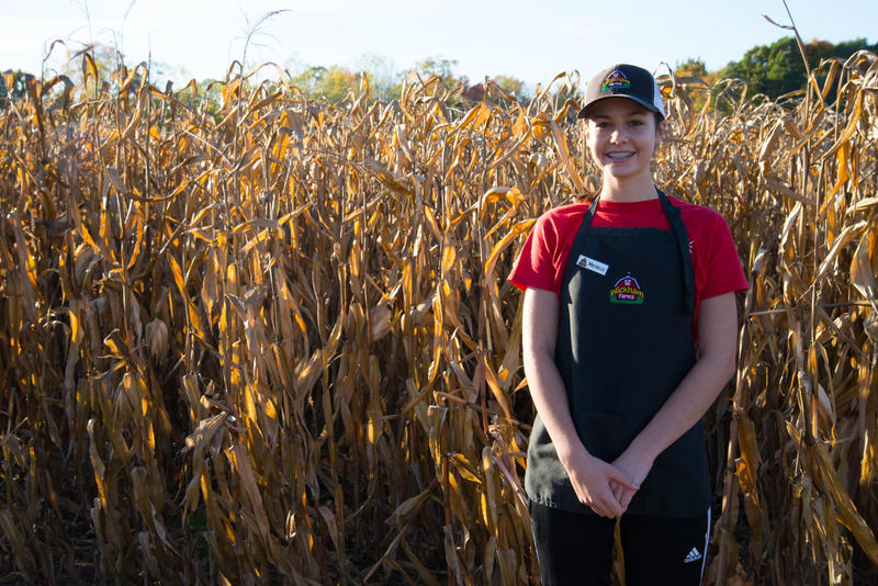 "Michelle Teich, 16, works for Wickham Farms in Penfield, N.Y. Teich earns $9 an hour and believes that her wage is livable for people in her age bracket. For older adults, ""it could be raised a little."""