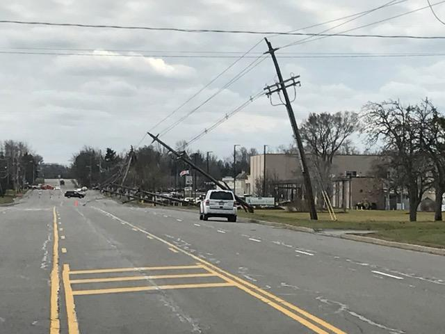 On South Winton Road in Henrietta, utility poles are snapped and bent.