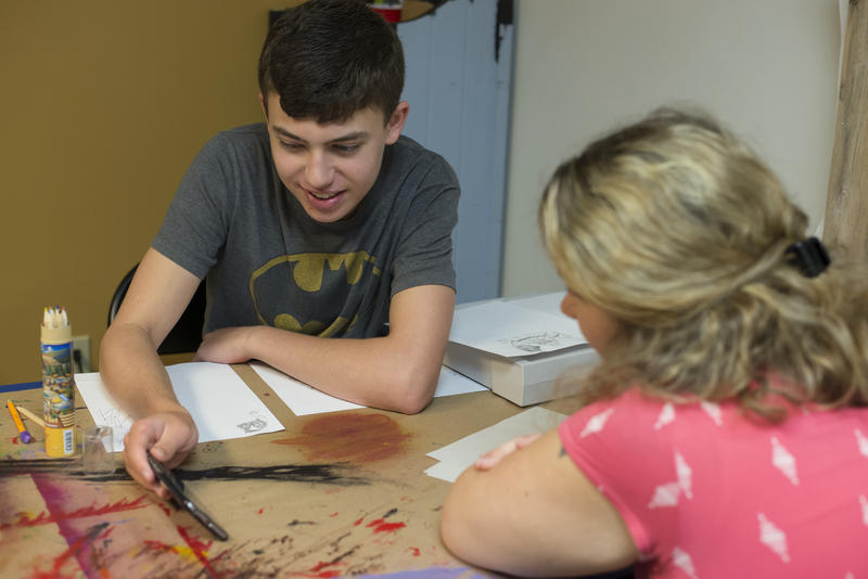 Erin Dougherty works with Nate Taylor during an art class at Spectrum Creative Arts in Pittsford.