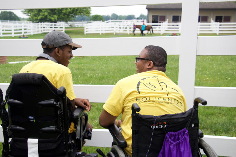 Akin chats with his classmate, Lewis Ingram, during their visit to EquiCenter.