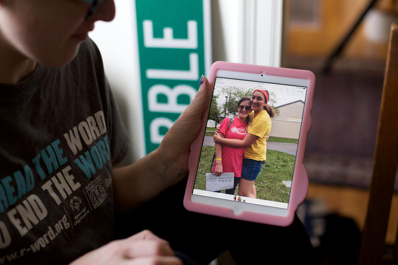 Maggie shows a photo of her and her friend, Tessa Berardi. They took an improv class together, and Tessa was a counselor at the Sunshine Camp that Maggie attended over the summer.