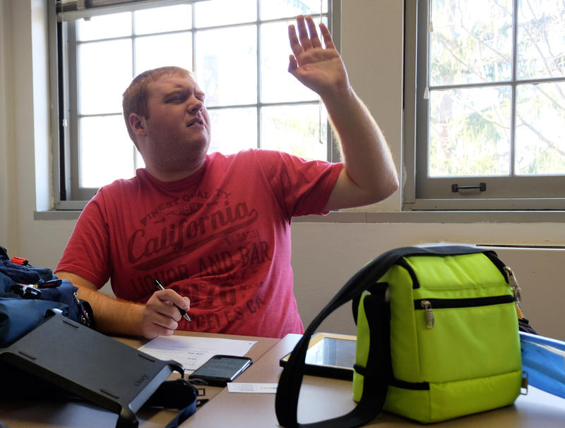 Jesse Claud raises his hand during a class in his LIVES program at SUNY Geneseo.
